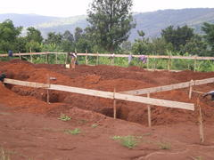 The                   start of the new dormitory/classroom/shower block