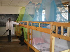 Mosquito nets benig used in                   Gihogwe School dormitory